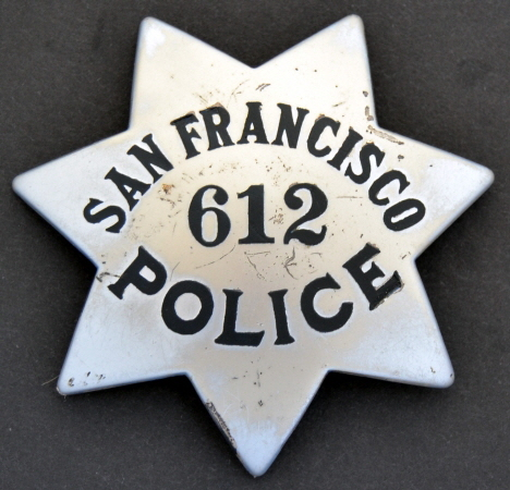 San Francisco Police Officer John Bacigalupi wearing badge #612, was appointed 8-8-21.  Made by Irvine & Jachens.  9-1-21.� Sterling.