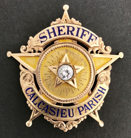 Calcasieu Co. Sheriff Henry A. Reid, Jr. gold badge.