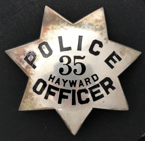 Hayward, CA Police badge #35, sterling silver, worn by Officer Bill Johnson.  Made by Irvine & Jachens and dated on the reverse 8-30-55.  Has Jewelry Workers Union Stamp #70.