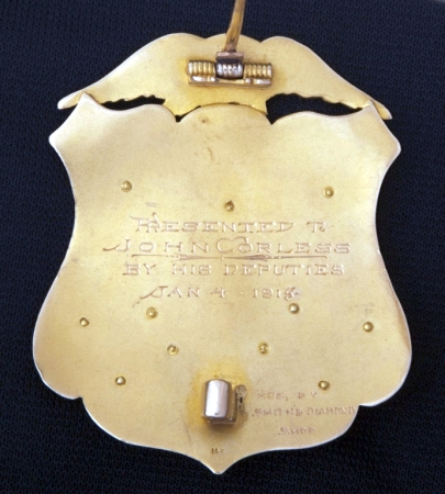 Presented to John Corless by his deputies Jan. 4, 1915.  Manufactured by Smith's Diamond Shop.